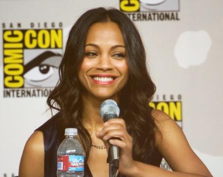 Zoe Saldaña smiles while answering a question